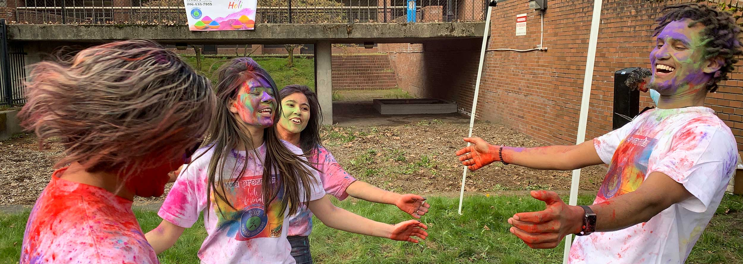 Student government painting and joking around at an event